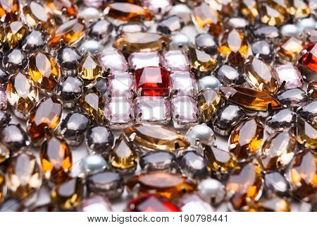 Colorful gemstones variety, precious stones background. Assortment of bright mounted gemstones, jewelry production concept