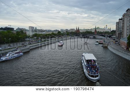 Russia Moscow 2017.05.20: Ship, boat on the Moscow river in the evening, on the background of the Kremlin.