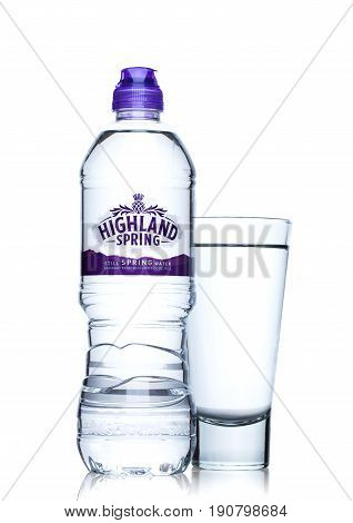 London, Uk - June 9, 2017: Bottle And Glass Of Highland Spring Still Mineral Water On White.