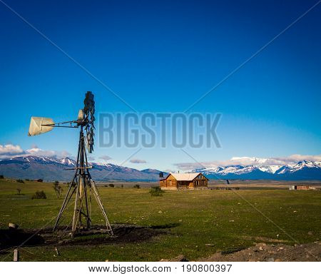Farm with a steel windmill in Patagonia