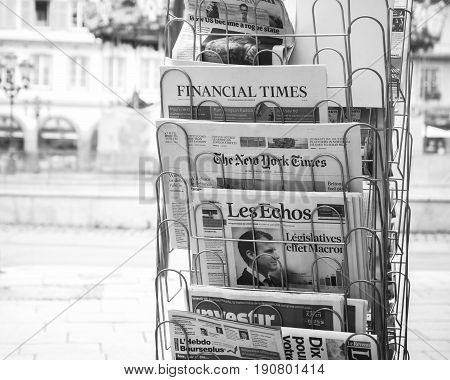STRASBOURG FRANCE - JUN 12 2017: Place Gutenberg press kiosk with international and French newspapers with reactions to French legislative election 2017 a day after first round