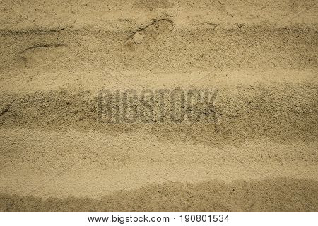 Trace Of The Human On A Yellow Sand . Sand Texture