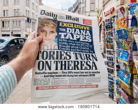 PARIS FRANCE - JUN 12 2017: Man point of view personal perspective buying at press kiosk Daily Mail newspaper Princessa Diana secret Tapes scandal and Theresa May elections in UK