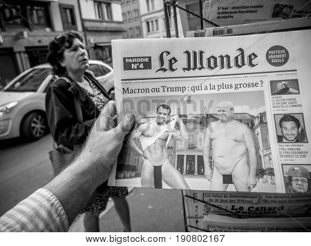 PARIS FRANCE - JUN 12 2017: Man point of view personal perspective buying at press kiosk French newspaper Le Wonde with reactions to French legislative election 2017 a day after first round