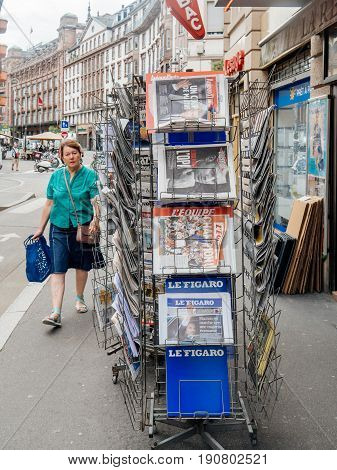 PARIS FRANCE - JUN 12 2017: French press kiosk with multiple newspapers featuring reactions to French legislative election 2017 a day after first round