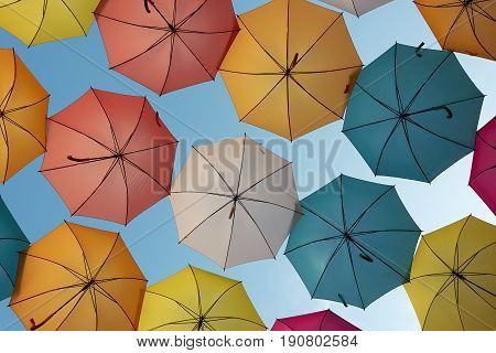 Colorful umbrellas in the blue sky,colorful umbrellas background