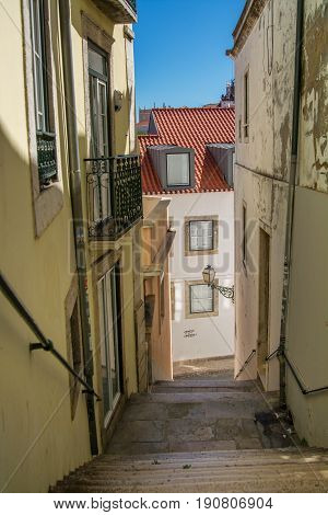 Lisbon Portugal. 05 June 2017.View of Lisbon narrow street stairs in Alfama. Lisbon Portugal. photography by Ricardo Rocha.