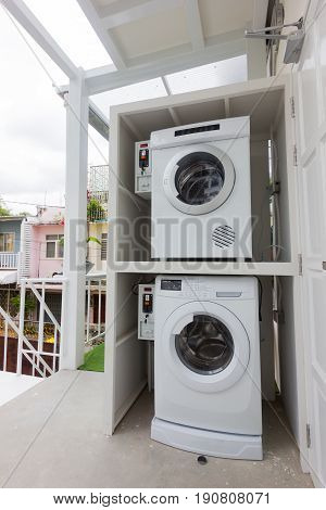 coin laundry machine service in a hostel in Thailand