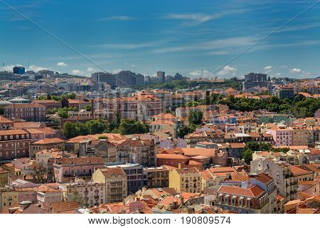 Lisbon Portugal. 05 June 2017.View of Lisbon town rooftops and tejo river from the Portas do Sol viewpoint in Alfama. Lisbon Portugal. photography by Ricardo Rocha.