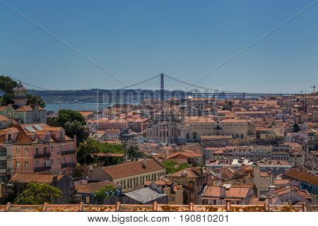 Lisbon Portugal. 05 June 2017.View of Lisbon town rooftops and tejo river from the Graca viewpoint in Alfama. Lisbon Portugal. photography by Ricardo Rocha.