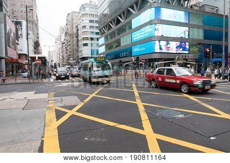 KOWLOON HONG KONG - APRIL 21 2017: Morning Traffic at Nathan Road Intersection Mong Kok in Kowloon Hong Kong.