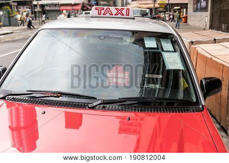 KOWLOON HONG KONG - APRIL 21 2017: Red Taxi Out of Service Cab Sign in Kowloon Hong Kong.
