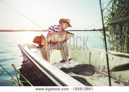 Ribar holds the big fish in his boat