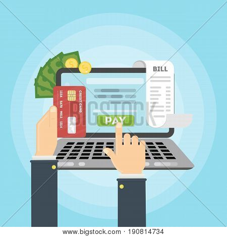 Paying bill online. Hands with laptop. Credit card, money and coins, bill papers.