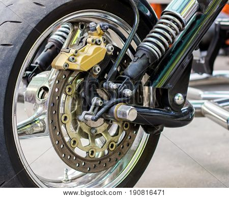 Motorcycle wheel close-up seen various details and how it is arranged