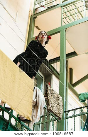 Girl Hanging Clothes On Laundry Line With Peg