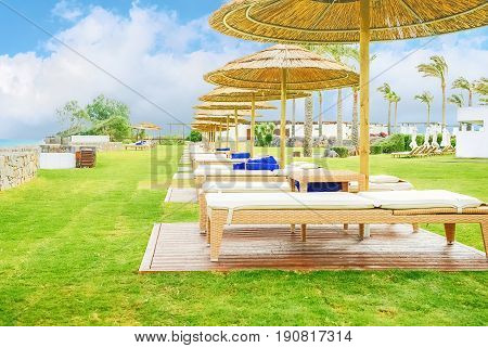 Solarium by the sea against a blue sky with white clouds on the island of Crete Greece