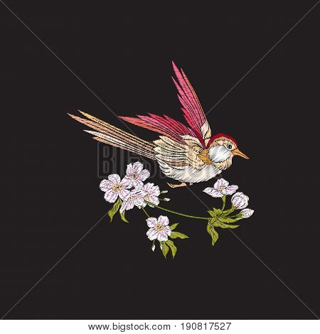 Embroidery flowers and swallow on black background. Stock line vector illustration.