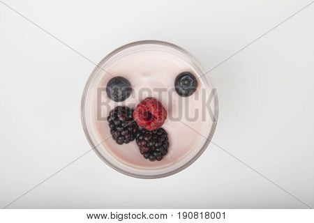 Glass Of Fresh Berries And Yogurt Isolated On White Background
