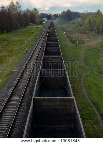 Fly view of railway tracks and empty freight train.