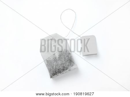 Teabag with white label. Isolated on white background