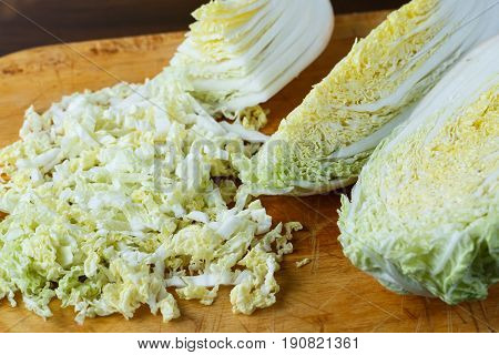 Chinese Cabbage Sliced On A Wooden Board