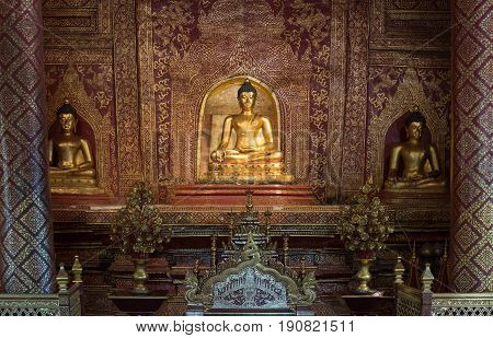 CHIANG MAI, THAILAND - FEBRUARY 6, 2016: The famous Phra Buddha Sihing at Wat Phra Singh in Chiang Mai. The construction of this temple was began in 1345.