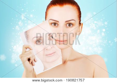 red haired woman releases her skin from old wrinkles