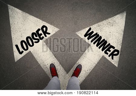 WINNER versus LOOSER written on the white arrows dilemmas concept.