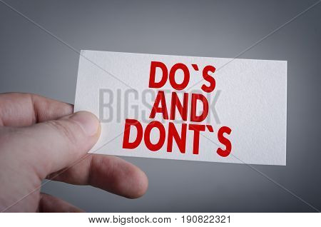 Do's and Don'ts white card in hand