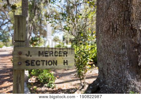 Savannah GA - March 28 2017: Sign marking Johnny Mercer gravesite in historic Bonaventure Cemetery Savannah. Mercer was a lyricist songwriter singer co-founder of Capital Records and 4-time Academy Award winner.