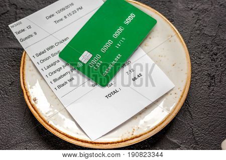 Credit Card For Paying, Plate And Check On Cafe Stone Desk Background