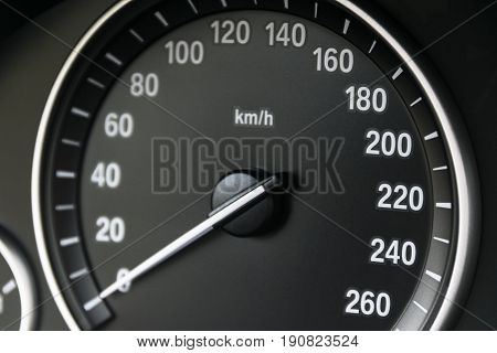 Car instrument panel dashboard closeup with visible speedometer car interior details