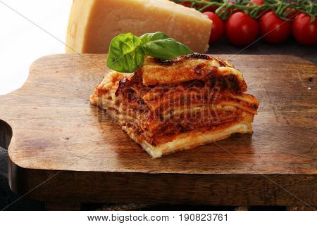 Serving Of Spicy Traditional Italian Beef Lasagne In A Restaurant - Bolognese Sauce Topped With Basi