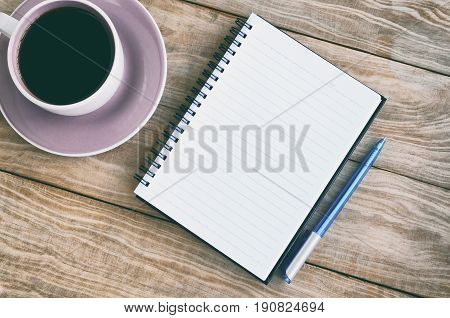 Top View Of Note Pad, Wood Table With Coffee And Pen Retro Styled.