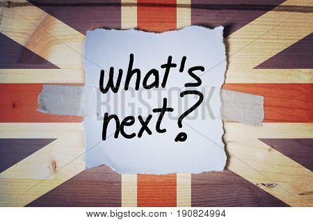 What's Next? on torn paper and the UK flag