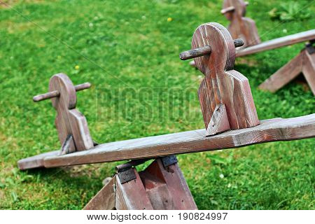 Wooden equipment on kinds playground in mountains
