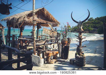 Arbor of beach cafe on the bank of the island Ko Samed