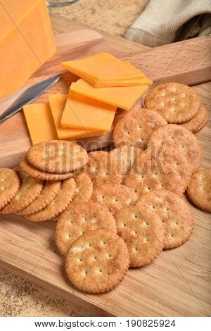 Overhead view of cheese and while wheat crackers