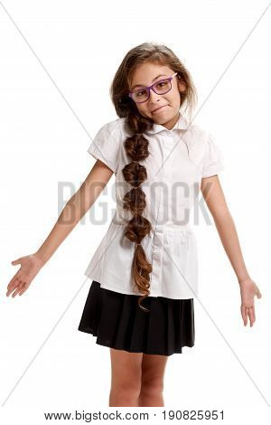 Young pretty schoolgirl gesturing I don't know
