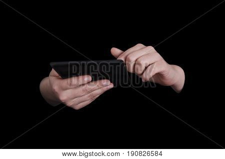 Female hands with tablet PC low key image