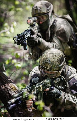 Group of soldiers special forces during raid in forest