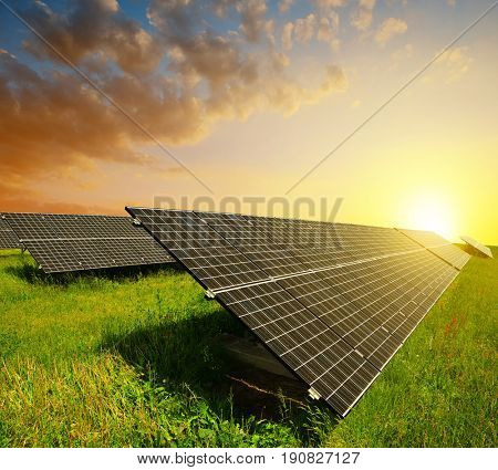 Solar panels at sunset. Photovoltaic station generate clean energy.