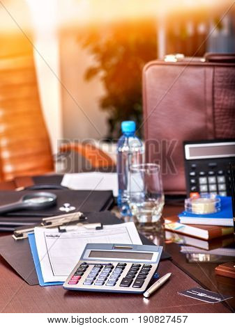 Business still life with stationery on table in office. Workplace of the accountant.backlight