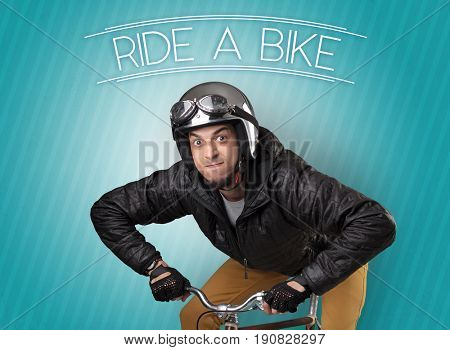 Kooky young guy on a bike with cyclist keywording and streaky background