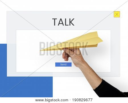 Hand holding paper airplane with word talk