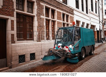 Cleaning machine on city street. Ecology concept