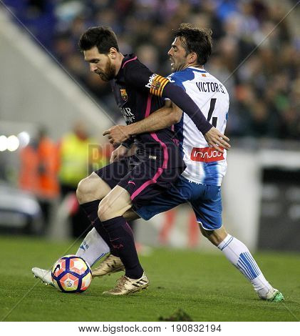 BARCELONA, SPAIN - APRIL, 29: Leo Messi(L) of FC Barcelona fights with Victor Alvarez(R) of RCD Espanyol during a Spanish League match at the RCDE Stadium on April 29 2017, in Barcelona Spain