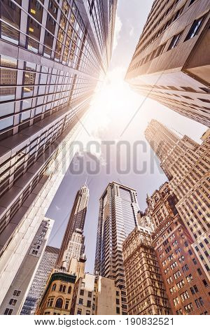 multiple skyskrapers in the sun seen from a low angle, Manhattan financial district, New York City