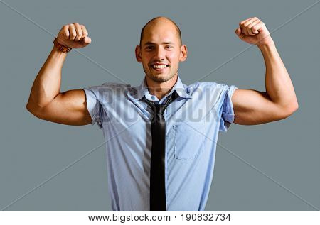 Strong businessman concept. Business man showing muscular hands